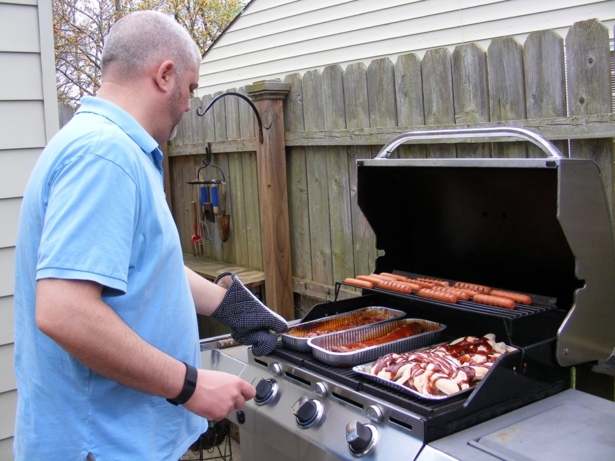 Alan cooking for the family in a gas smoker.