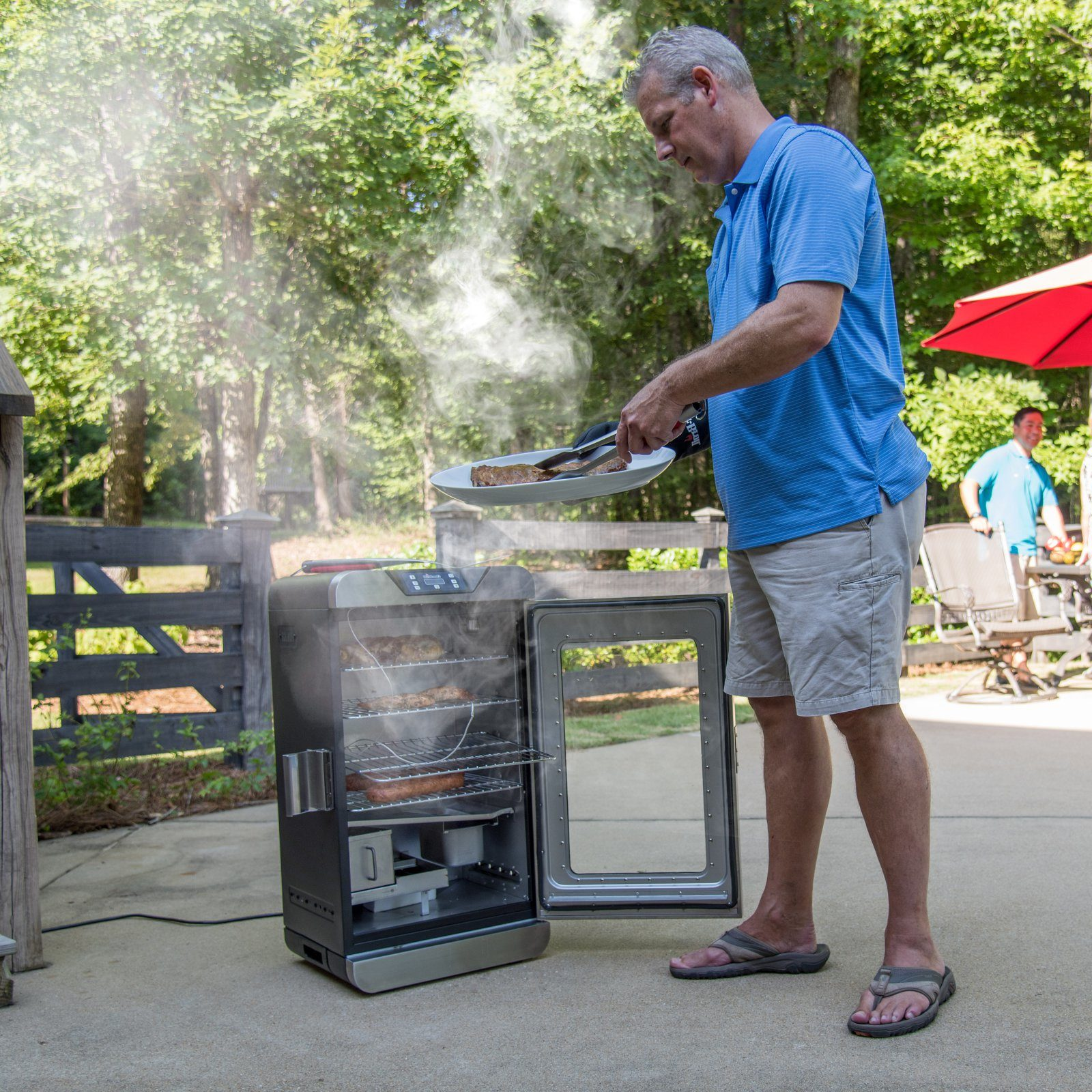 David cooking with his new electric smoker grill.