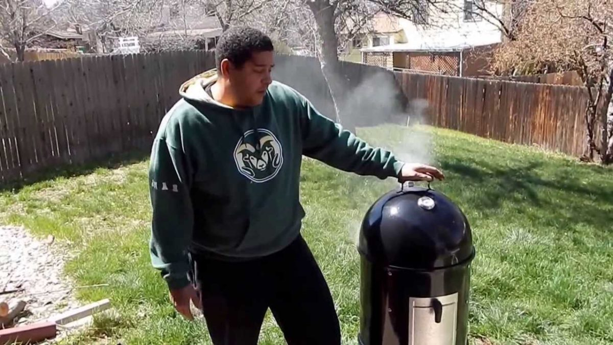 Jordan using his new Weber Smoker.