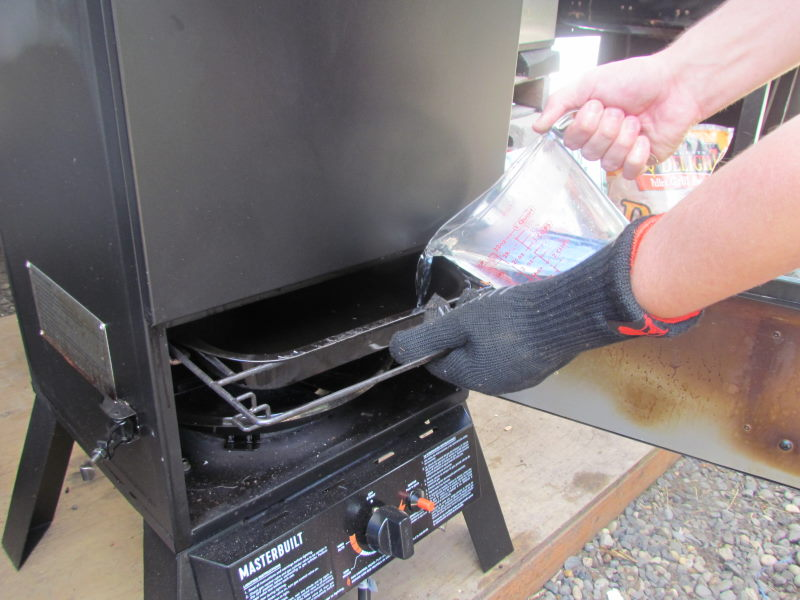 How do I add water to the Masterbuilt Propane Smoker